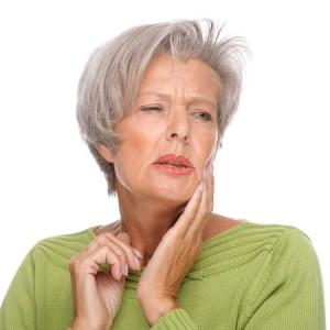 Zahnschmerzen, Karies, dicke Backe, Loch im Zahn,